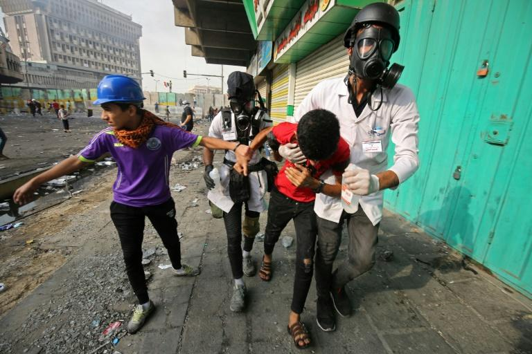 Protests continued in Baghdad on Thursday, with medics reporting four demonstrators killed by teargas canisters (AFP Photo/AHMAD AL-RUBAYE)