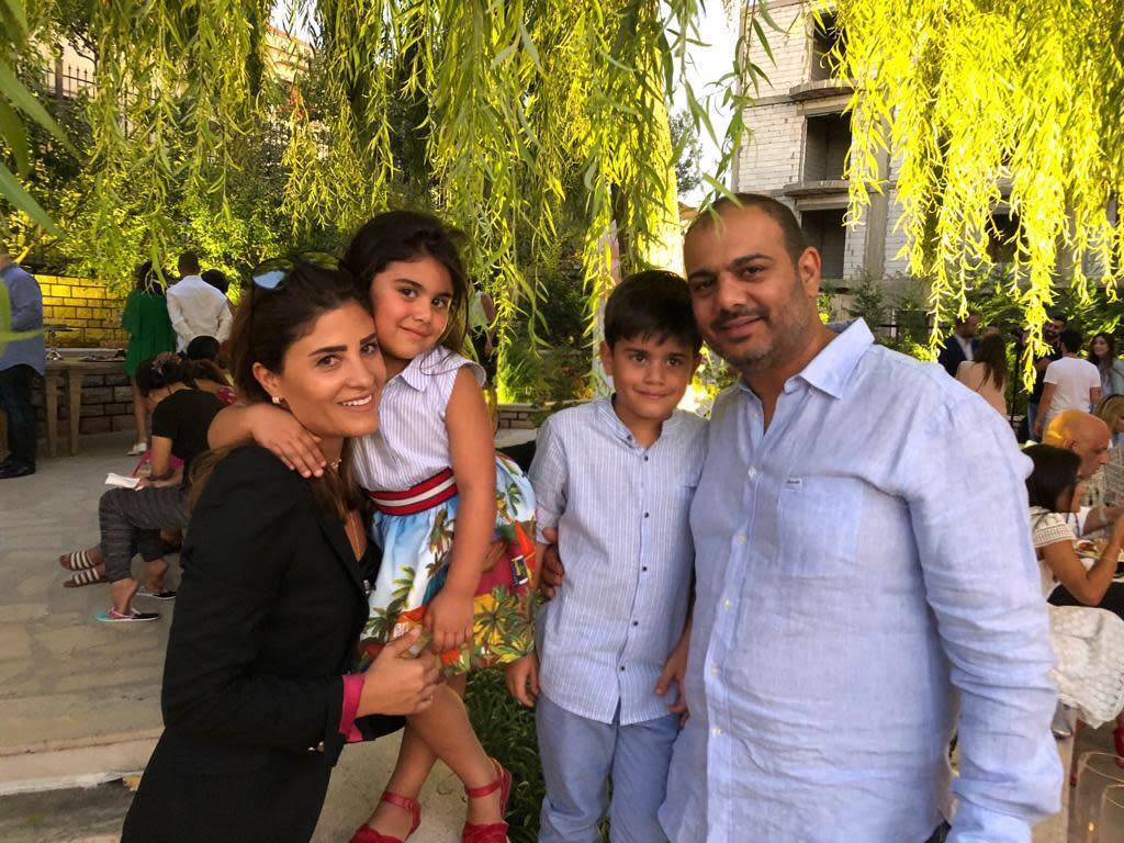 This Aug. 19, 2019 photo photo provided by Soha Saade,, shows Soha and her husband Jihad with their children Gemma and Karl, in Miziara, north of Lebanon. Jihad died in his wife's hands while staying with their sick six-year-old daughter at a hospital in a massive explosion that devastated Beirut Tuesday, Aug. 4, 2020. (Soha Saade via AP)