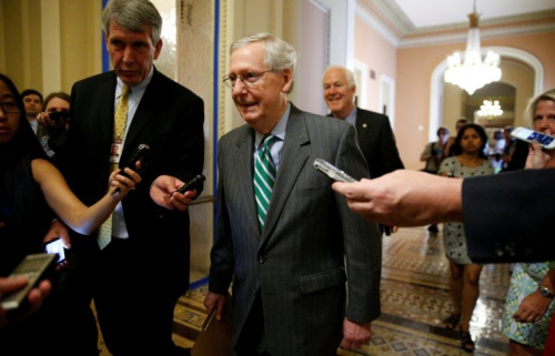 Senator Majority Leader Mitch McConnell walks to the Senate floor after unveiling a draft bill on health care.