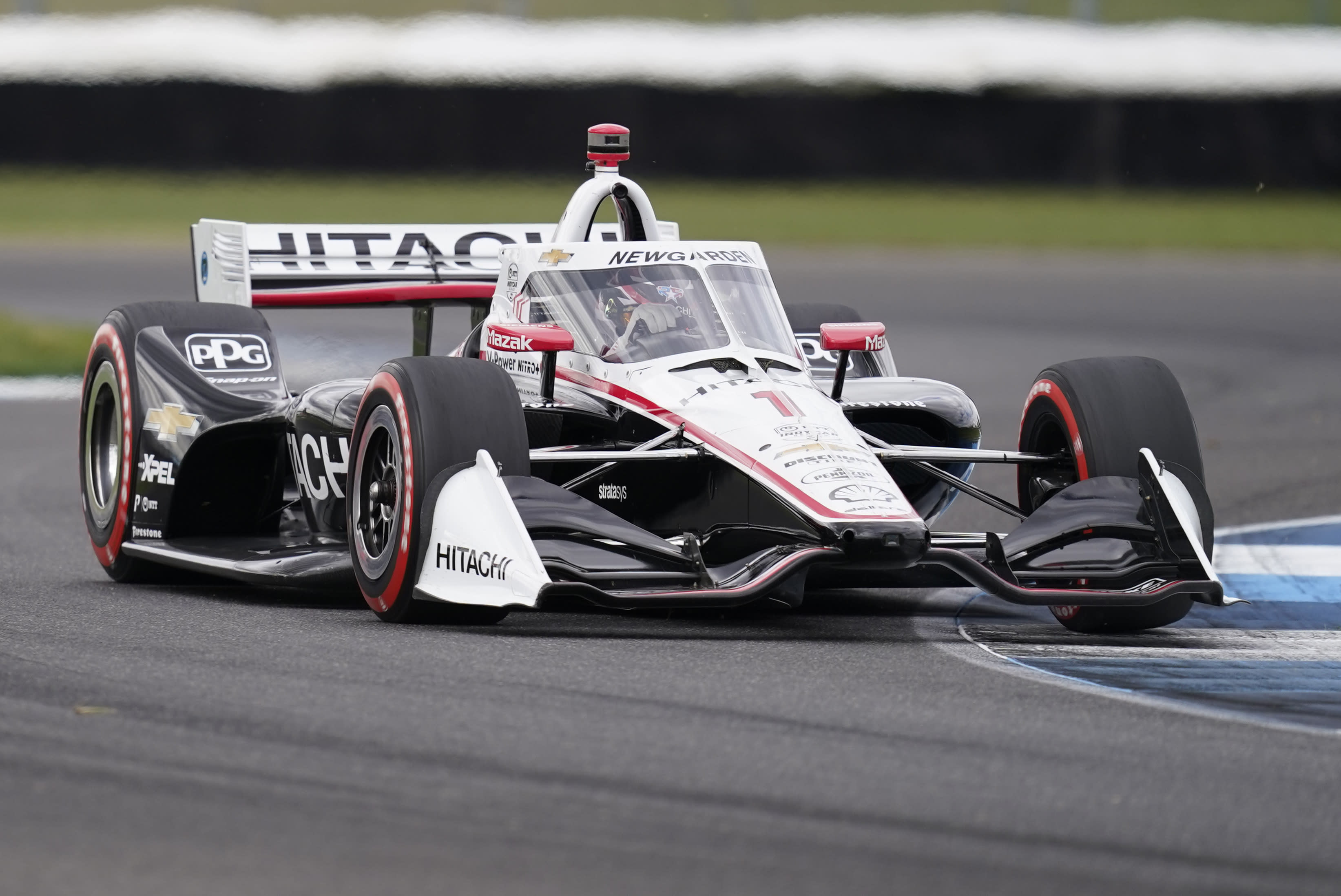 Josef Newgarden drives into a turn during an IndyCar auto race at Indianapolis Motor Speedway, Friday, Oct. 2, 2020, in Indianapolis. (AP Photo/Darron Cummings)