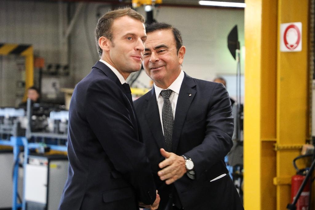 French President Emmanuel Macron, seen here with Ghosn at a Renault factory visit this month, said his government would be 'extremely vigilant' about the automaker's stability (AFP Photo/ludovic MARIN)