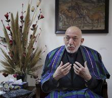 Afghanistan's Karzai tells AP that US cash fed corruption