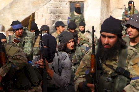 Members of al Qaeda's Nusra Front gather before moving towards their positions during an offensive to take control of the northwestern city of Ariha from forces loyal to Syria's President Bashar al-Assad, in Idlib province May 28, 2015. REUTERS/Ammar Abdullah