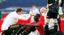 Eric Bailly: Manchester United star forced off on stretcher with head injury after Harry Maguire collision
