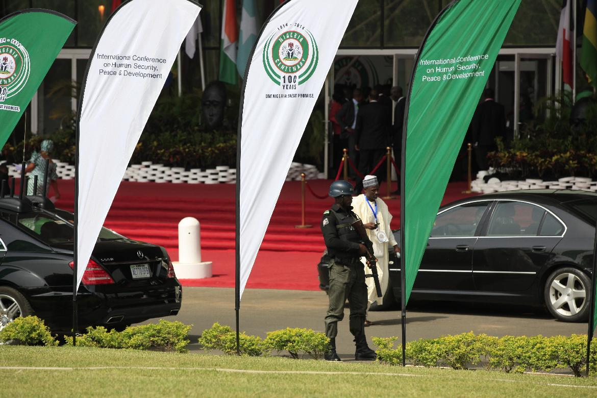 A Nigerian police officer stand guards outside the venue for the summit on security during an event marking the centenary of the unification of Nigeria's north and south in Abuja, Nigeria, Thursday, Feb. 27, 2014, . (AP Photo/Sunday Alamba)