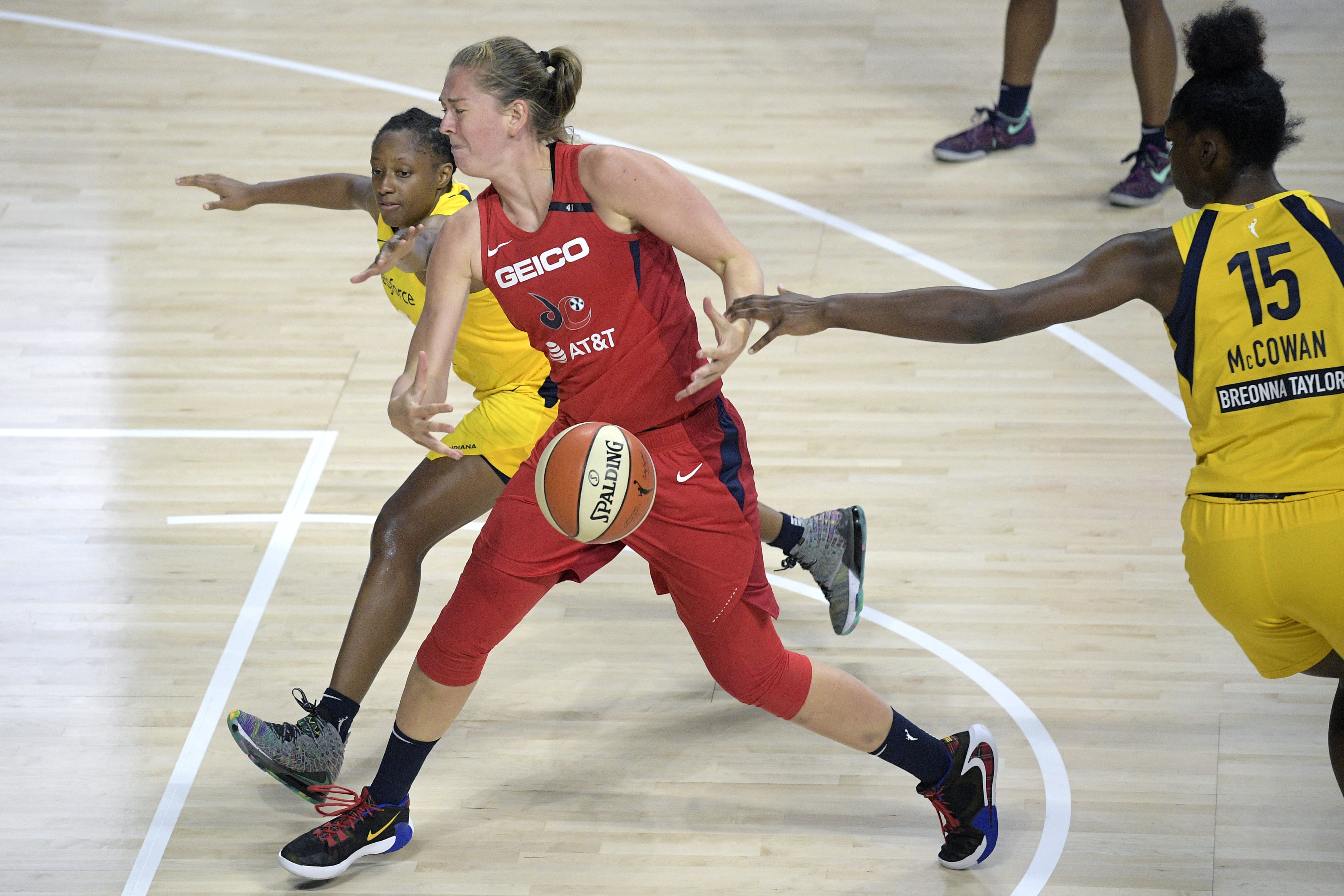 Indiana Fever's Teaira McCowan (15) strips the ball away from Washington Mystics forward Emma Meesseman, center, as Fever guard Kelsey Mitchell helps defend during the first half of a WNBA basketball game, Saturday, July 25, 2020, in Ellenton, Fla. (AP Photo/Phelan M. Ebenhack)