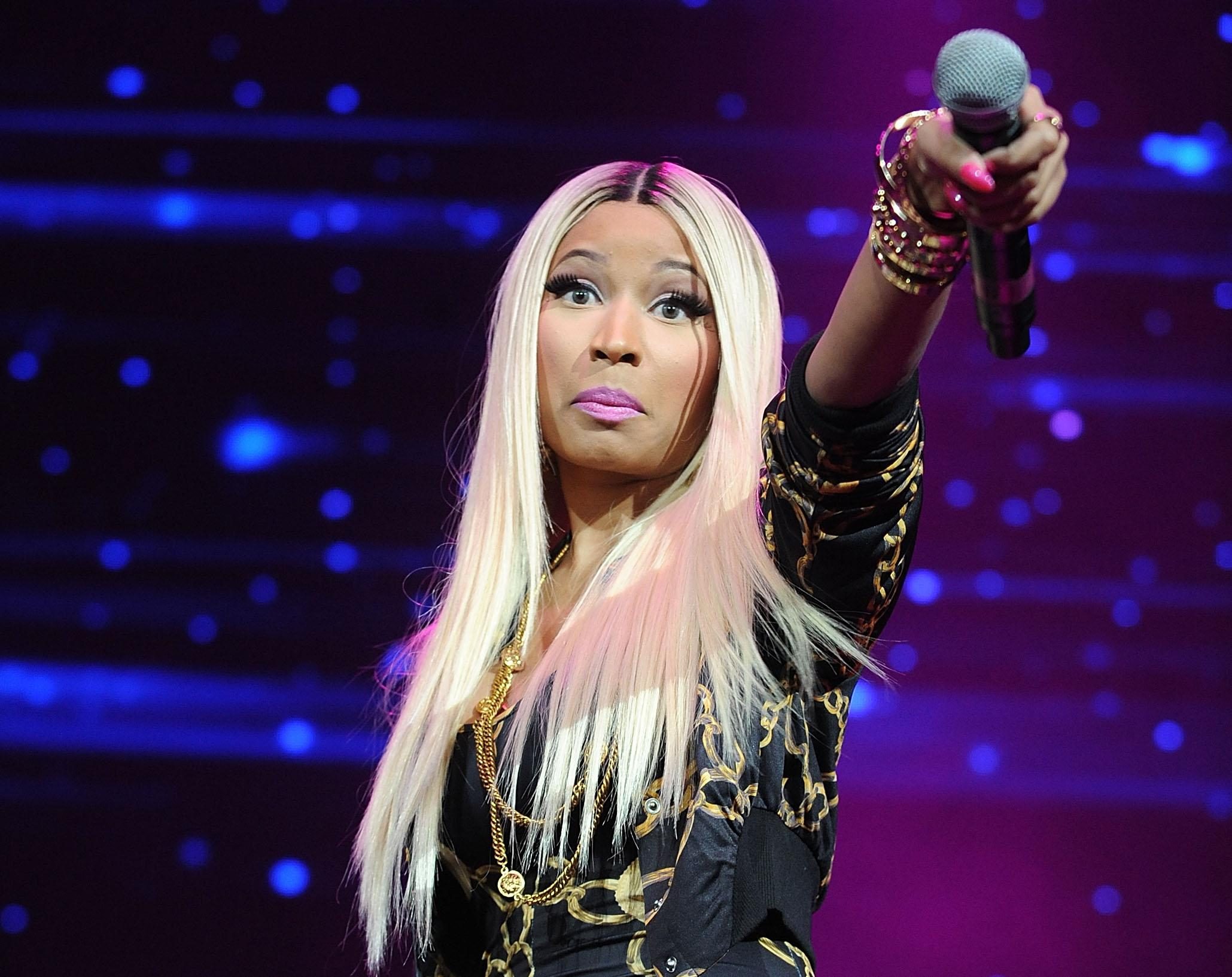 FILE - This Nov. 2, 2013 file photo shows hip-hop artist Nicki Minaj at the Power 105.1's Powerhouse Concert at the Barclays Center in New York. Minaj is being criticized after using a photo of Malcolm X with a gun in his hands, juxtaposed with a racial slur, for her new single. Minaj posted the photo Wednesday, Feb. 12, 2014, on her website and Instagram page. The rapper was bashed on social media for the using the famous image of the black nationalist, assassinated 49 years ago this month on her single cover. (Photo by Brad Barket/Invision/AP, File)