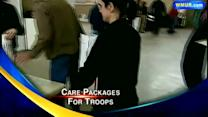Governor helps prepare care packages for troops