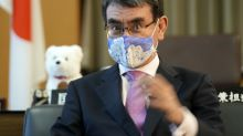 The AP Interview: Japan minister urges vaccines for young