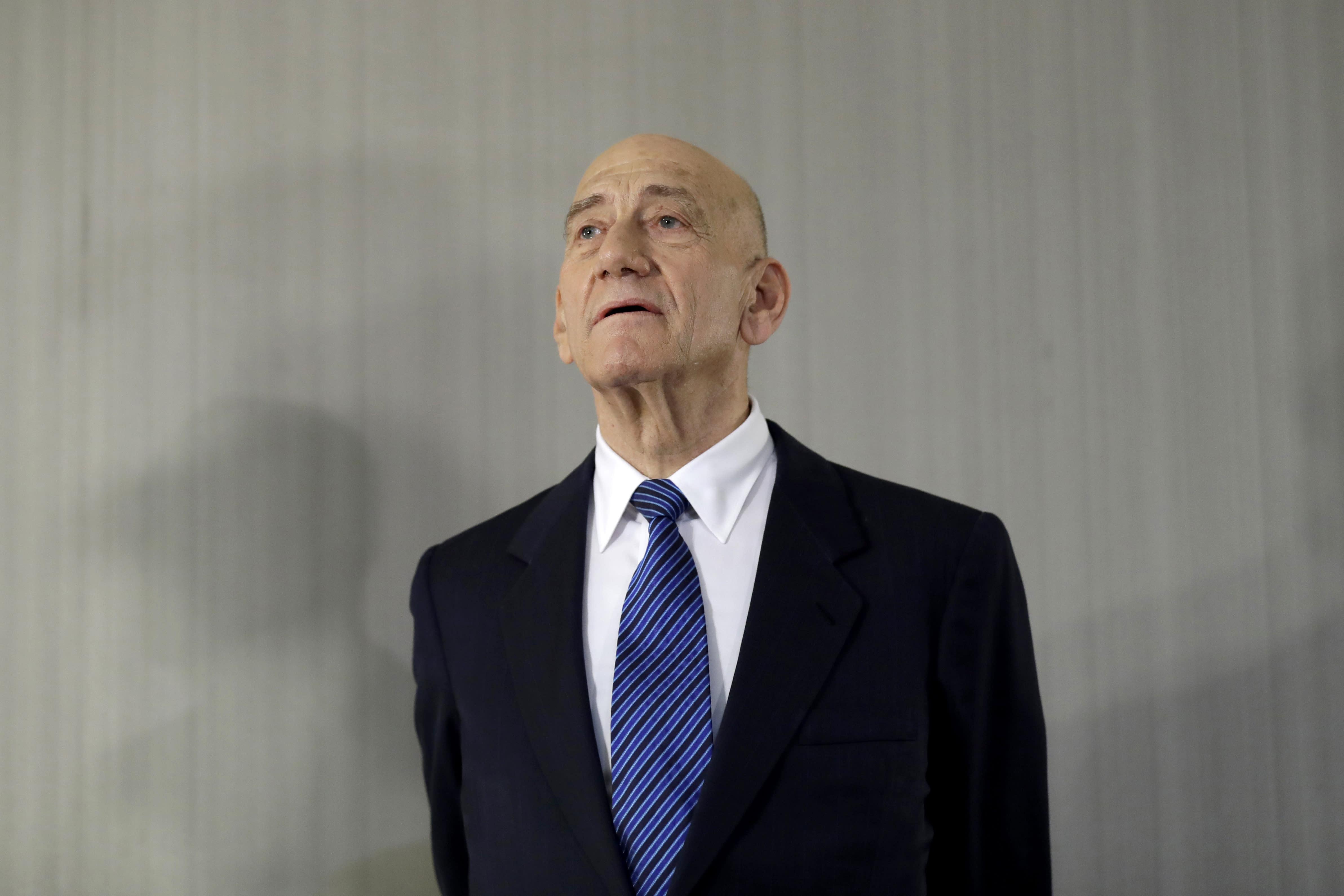Israeli PM threatens defamation suit against predecessor