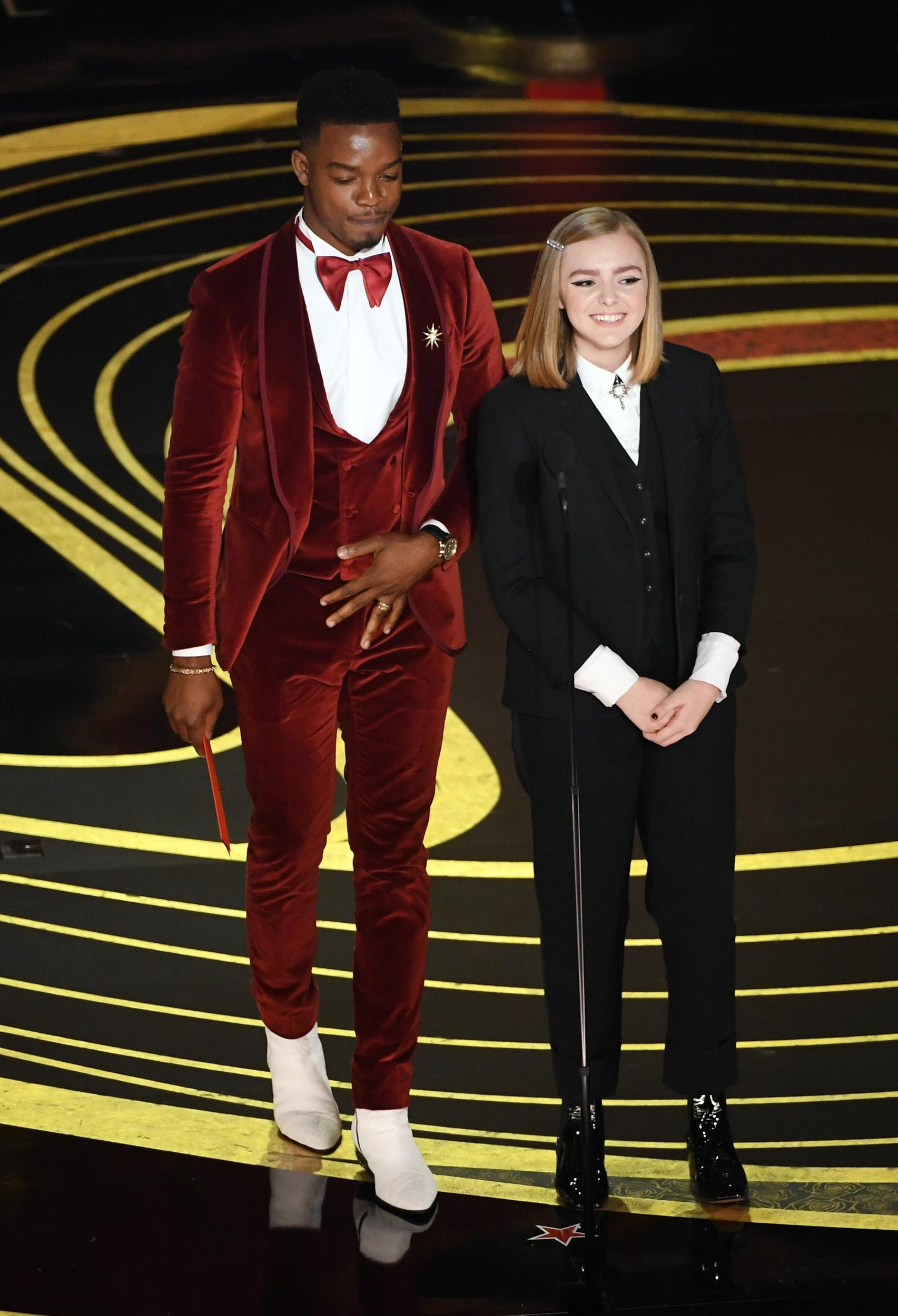 HOLLYWOOD, CALIFORNIA - FEBRUARY 24: (L-R) Stephan James and Elsie Fisher speak onstage during the 91st Annual Academy Awards at Dolby Theatre on February 24, 2019 in Hollywood, California. (Photo by Kevin Winter/Getty Images)