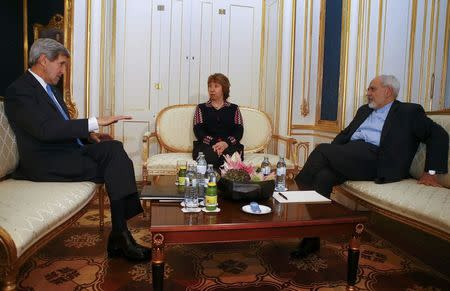 U.S. Secretary of State Kerry, Iranian FM Zarif and EU envoy Ashton pose for photographers in Vienna
