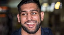 Muslim Amir Khan issued death threats and abuse for putting up a Christmas tree