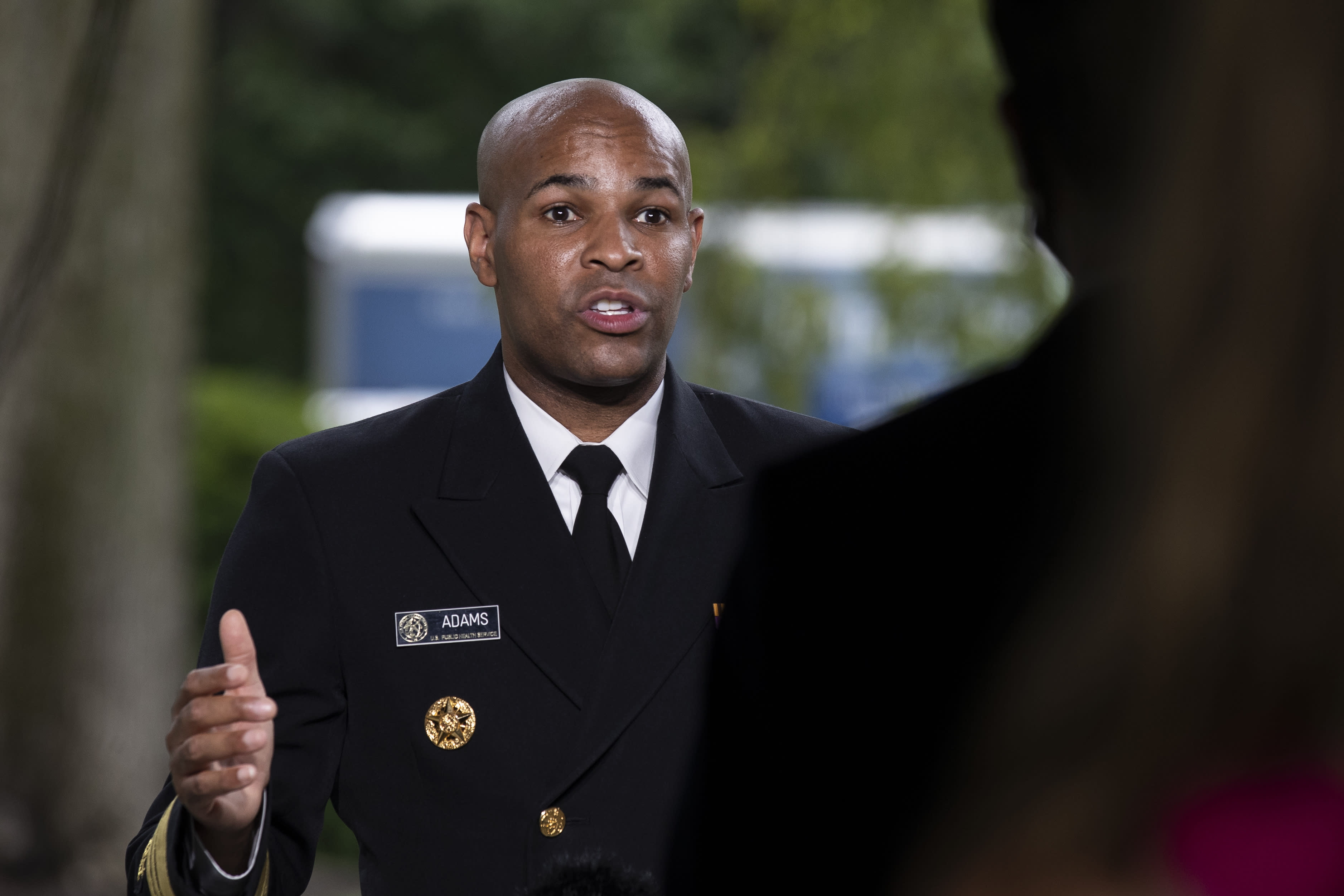 U.S. Surgeon General Jerome Adams does a television interview on the North Lawn of the White House, Tuesday, July 7, 2020, in Washington. (AP Photo/Alex Brandon)