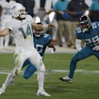 Ryan Fitzpatrick tosses two touchdowns, runs for a third as Dolphins earn 31-13 win over Jaguars