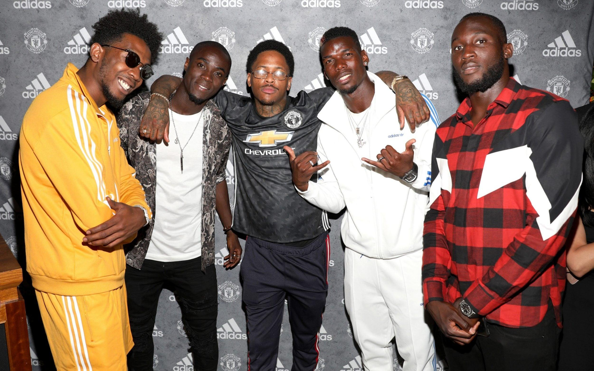 Pogba, pictured in 2017 alongside rappers Desiigner and YG and fellow players Eric Bailly and Romelu Lukaku —Meet the real Paul Pogba: The teetotal polyglot who helps unite the Manchester United dressing room - GETTY IMAGES