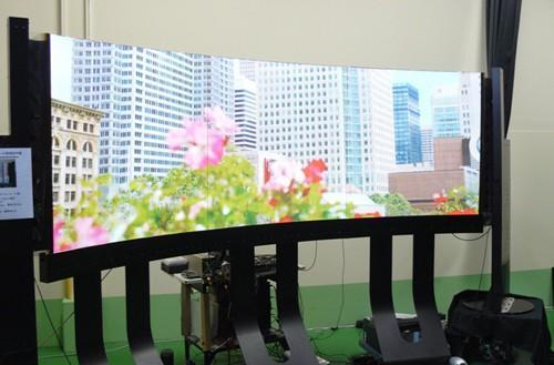 Shinoda's 125-inch curved plasma to hit assembly lines by May, all 7.9-pounds of it