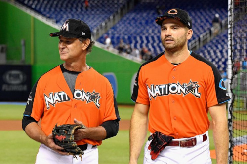 Joey Votto (right) made sure Zack Cozart got the ball from his first All-Star hit. (Getty Images)