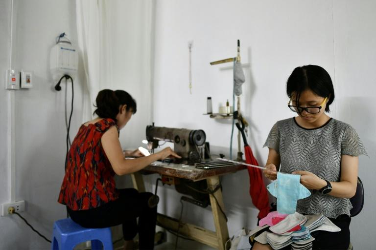 Bui Thi Minh Ngoc wanted to find a sustainable alternative to standard menstrual products (AFP Photo/Manan VATSYAYANA)