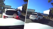 Video shows woman back into car, but it's what she does next that sparks fury