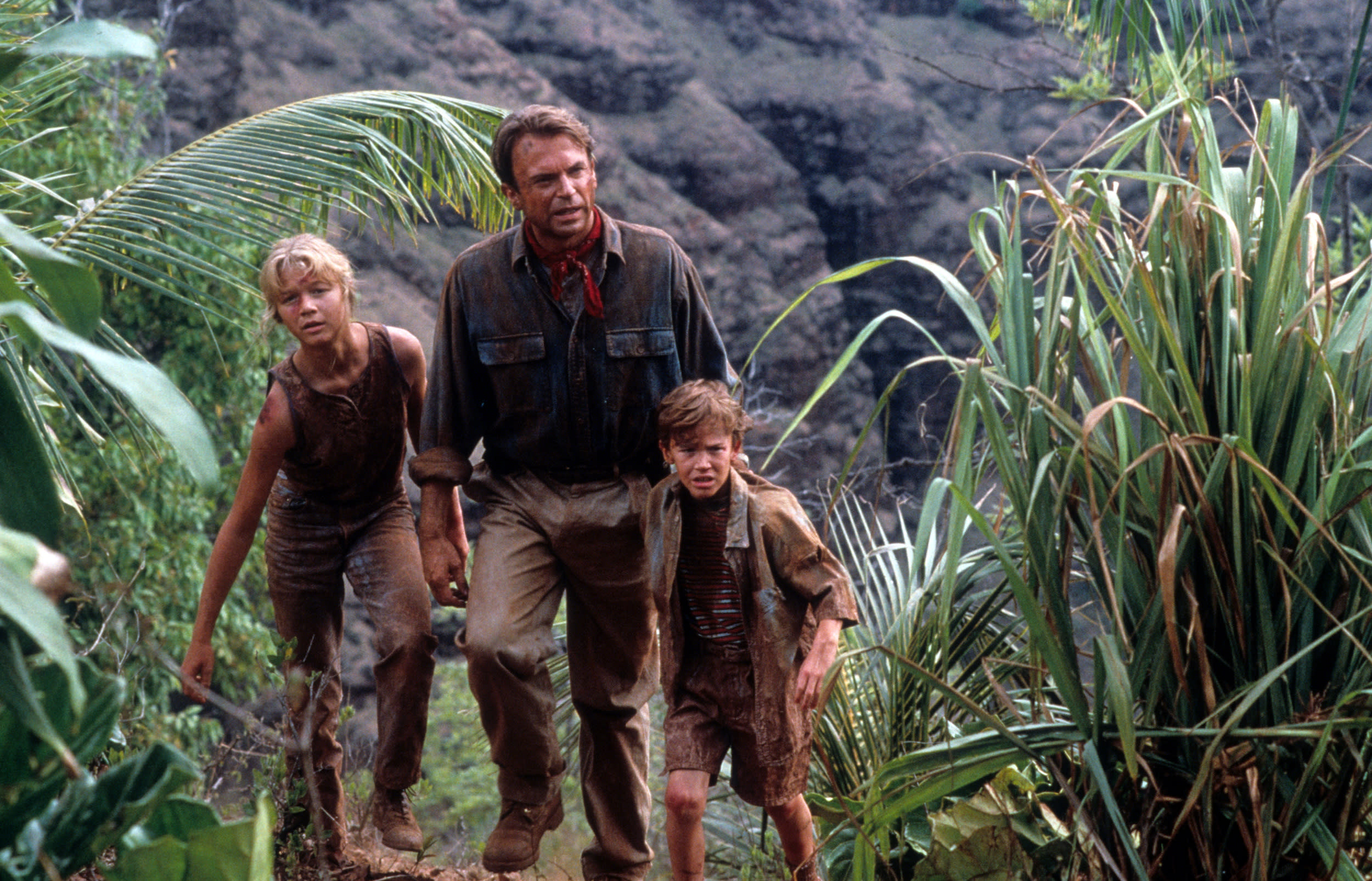 Ariana Richards walks with Sam Neill and Joseph Mazzello in a scene from the film 'Jurassic Park', 1993. (Photo by Universal/Getty Images)