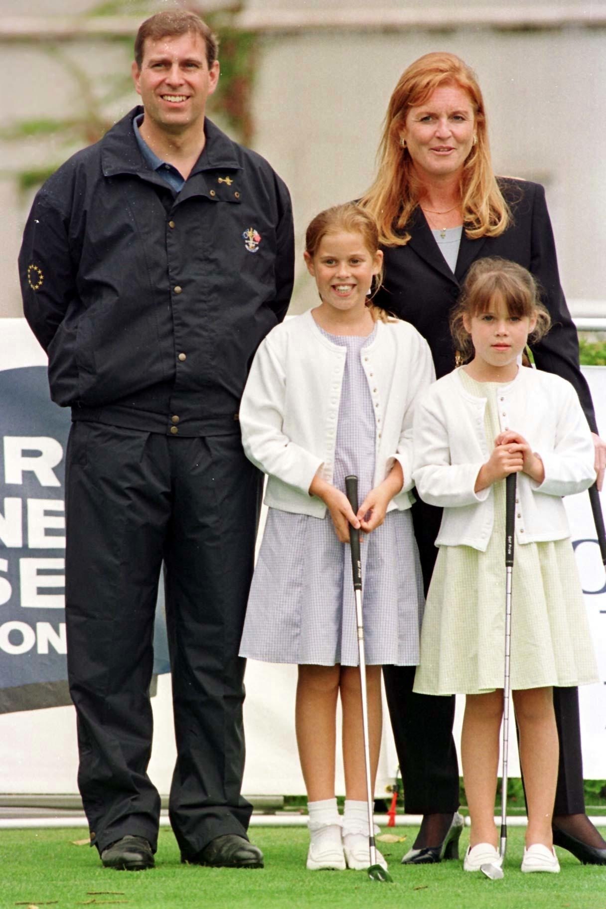 The Duke and Duchess of  York with their daughters Princesses Beatrice (left) and Eugenie, at Wentworth Golf Club, Surrey, for the Duchess of York's fifth charity golf tournament  in aid of the Motor Neurone Disease Association.
