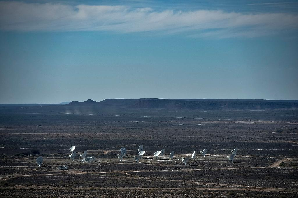 When fully up and running in the 2020s, the SKA will comprise a forest of 3,000 dishes spread over an area of a square kilometre (0.4 square miles) across remote terrain around several countries (AFP Photo/Mujahid Safodien)