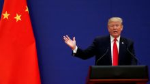 Trump accuses China of using trade to target election, threatens retaliation