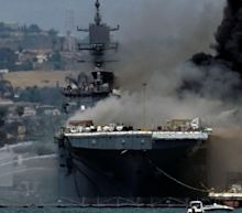 Firefighters battle massive blaze on US navy ship after explosion in San Diego