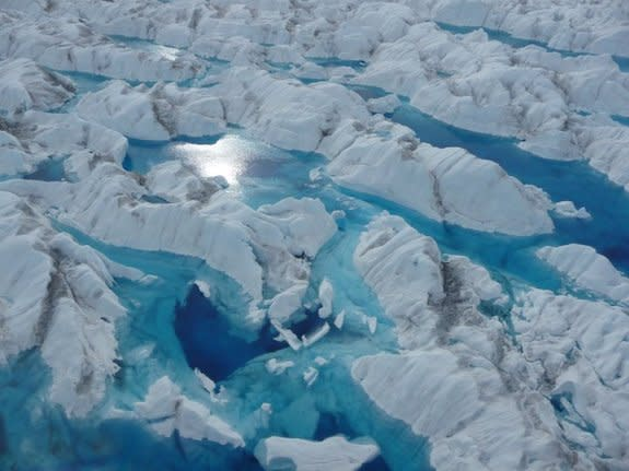 Water-filled surface crevasses on Greenland outlet glaciers.