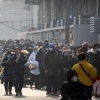AP PHOTOS: Long lines as Beijing expands mass COVID testing