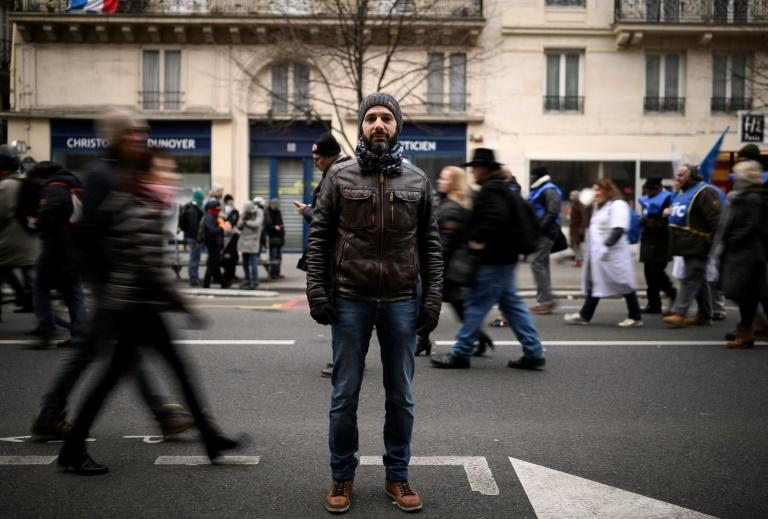 Romain, a 37-year-old teacher says he is protesting against an 'entire system' (AFP Photo/Lionel BONAVENTURE)