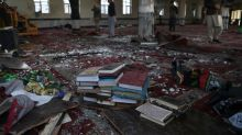 Smell of death permeates Kabul mosque hit by suicide bomber