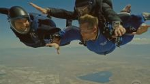 Tom Cruise messes with James Corden while skydiving