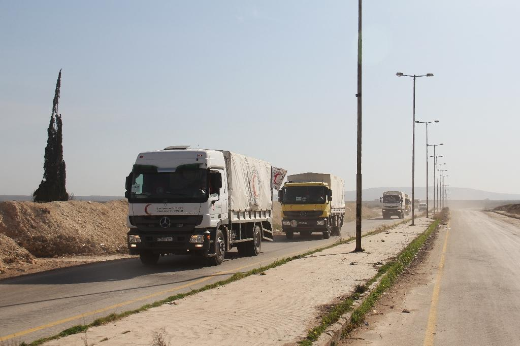 The just concluded aid mission to five besieged Syrian areas included 114 trucks and delivered supplies to an estimated 80,000 people (AFP Photo/Omar haj kadour)