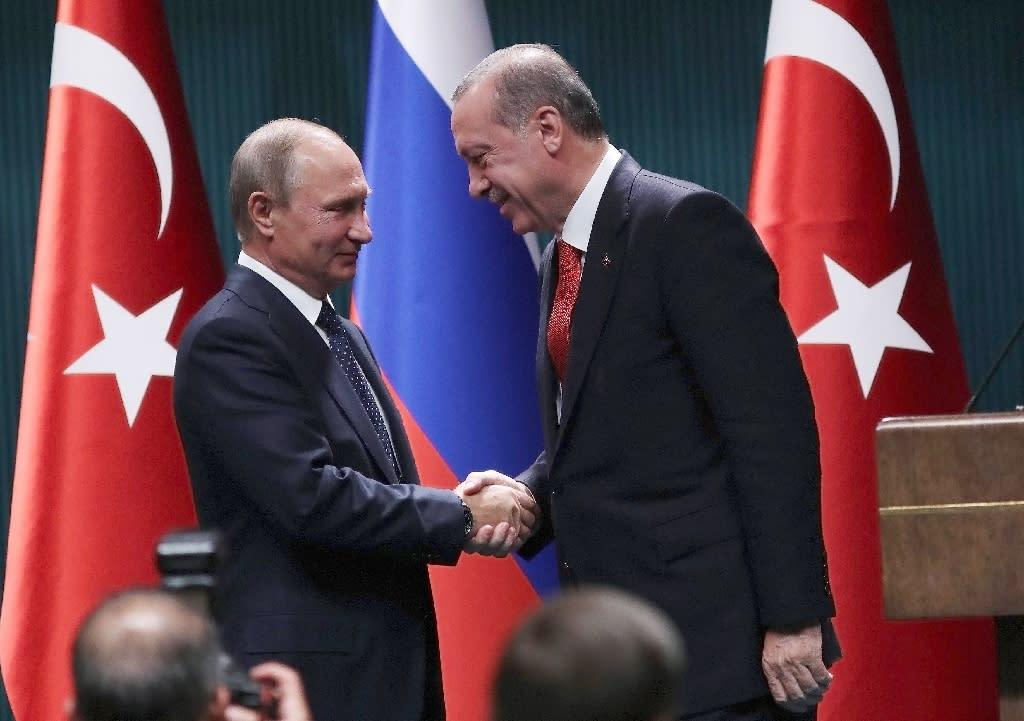 Russian President Vladimir Putin and Turkish President Recep Tayyip Erdogan shake hands during a previous meeting in Ankara in September