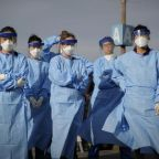 Health care professionals continue working despite shortages of protective gear