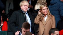 Carrie Symonds wraps up baby bump in camel coat and shows off engagement ring at rugby match