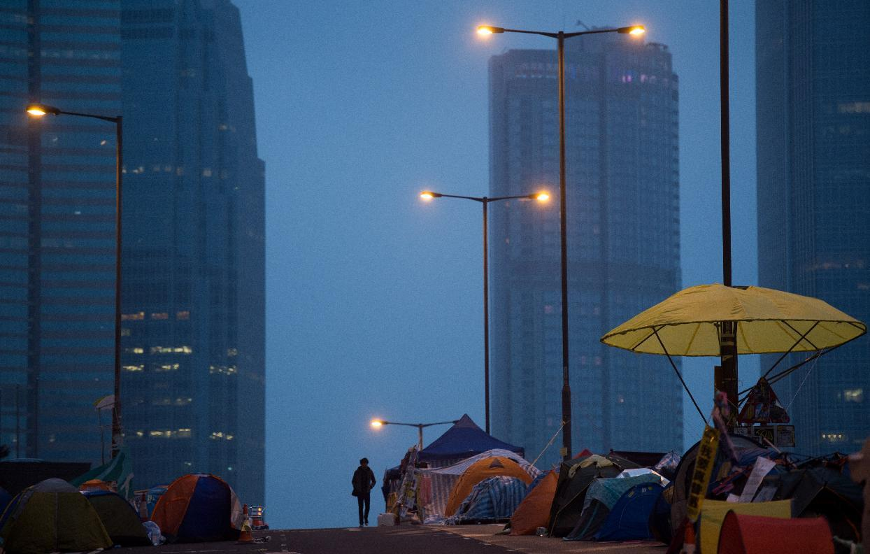A man walks along a flyover at the pro-democracy movement's main protest site in the Admiralty district of Hong Kong early on December 3, 2014