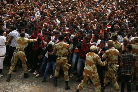 File photo of demonstrators chanting slogans while flashing the Oromo protest gesture during Irreecha, the thanksgiving festival of the Oromo people, in Bishoftu town, Oromiya region, Ethiopia
