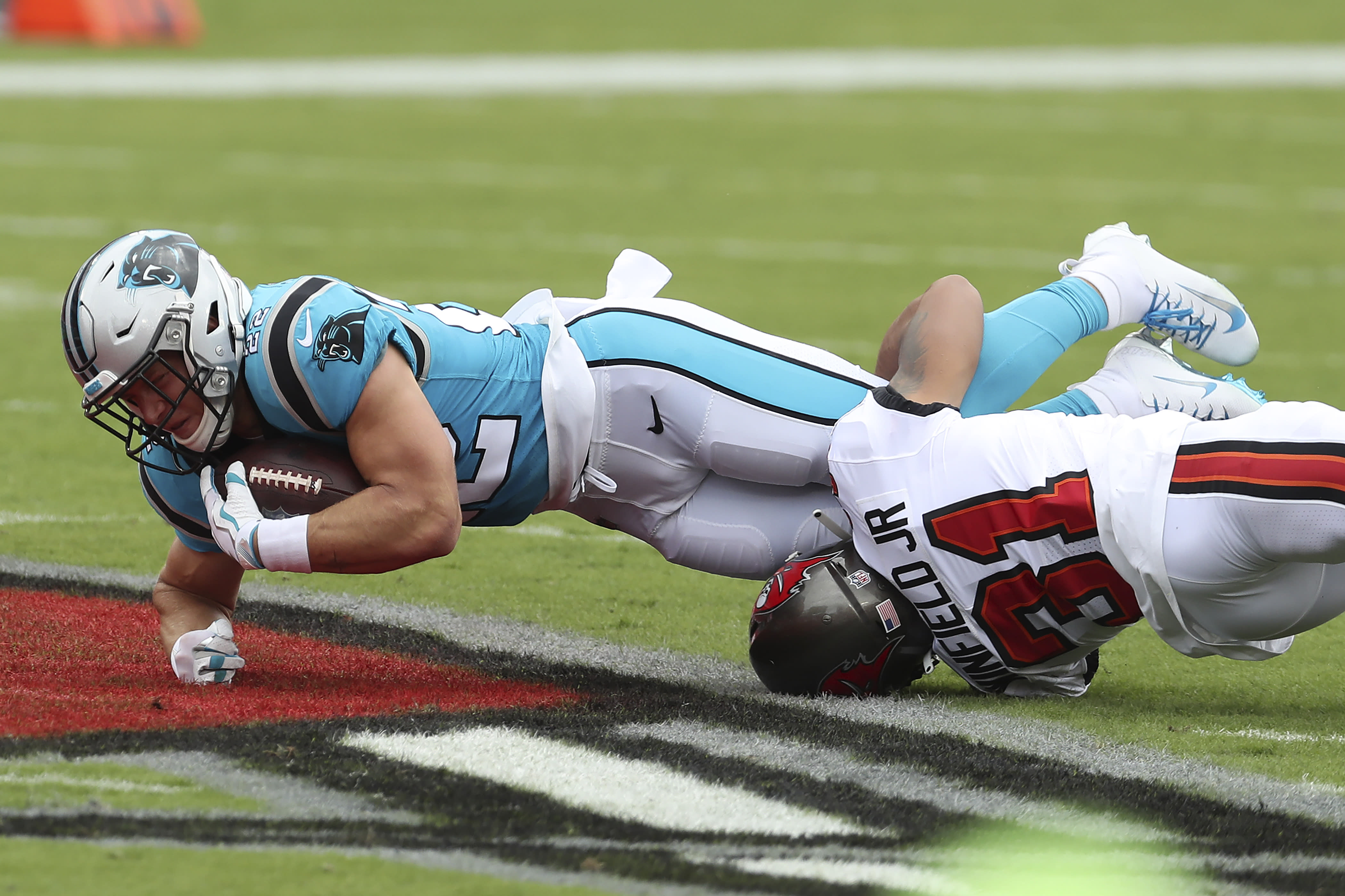 Carolina Panthers running back Christian McCaffrey (22) gets taken down by Tampa Bay Buccaneers safety Antoine Winfield Jr. (31) during the first half of an NFL football game Sunday, Sept. 20, 2020, in Tampa, Fla. (AP Photo/Mark LoMoglio)