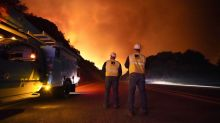 52 rescued as wildfires consume California