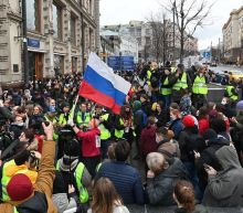 Putin warns the West as Russian police detain almost 1,800 Navalny protesters