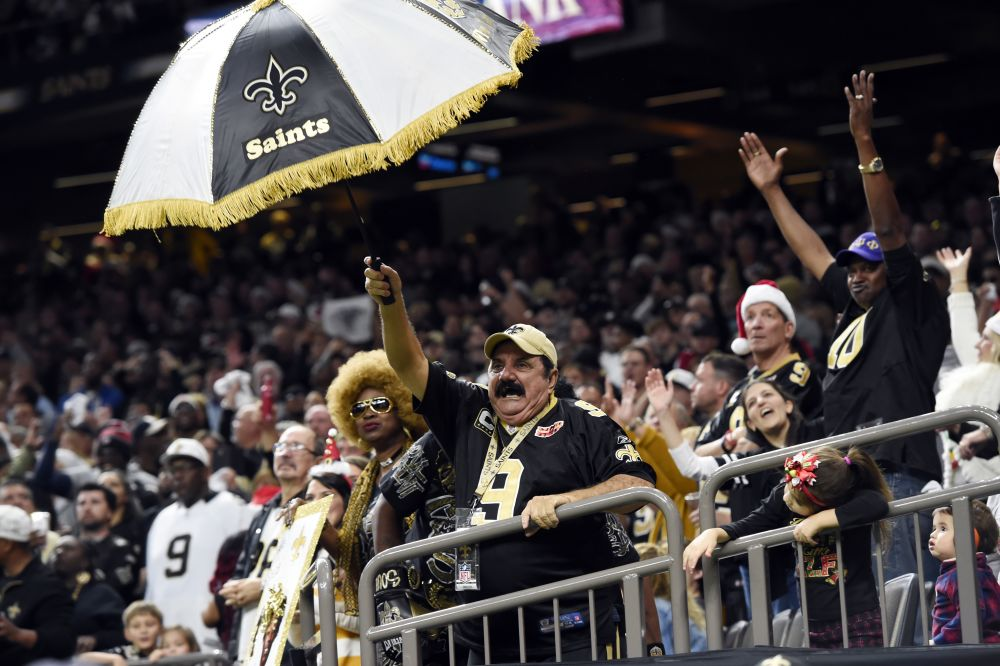 New Orleans Saints fans celebrate in the second half of a win over the Falcons in Week 16. (AP)