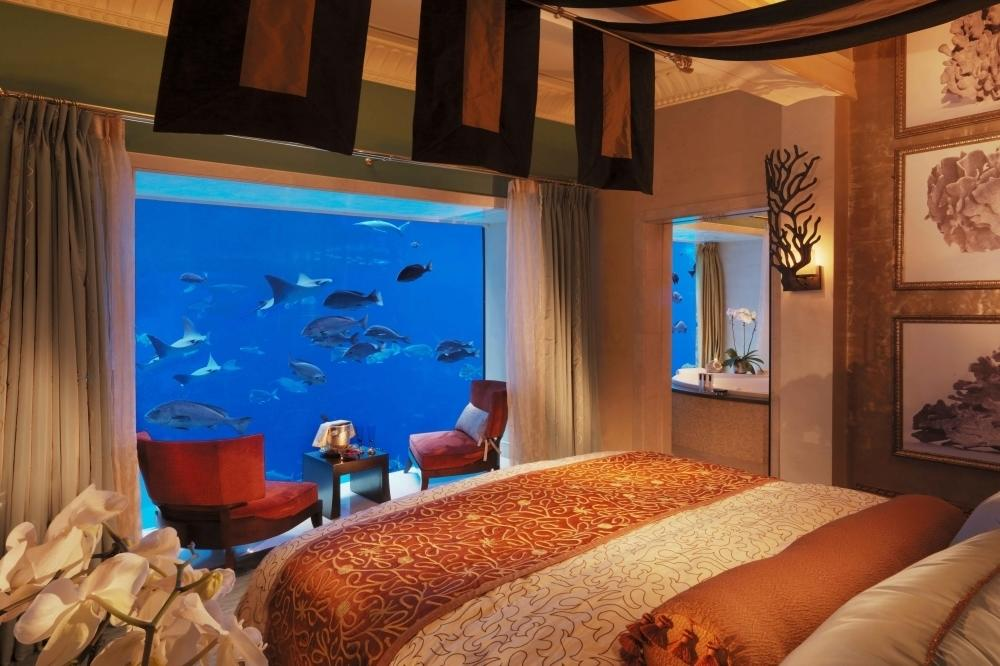 """Perfect for a unique experience in Dubai, the <a href=""""https://www.atlantisthepalm.com/hotel-rooms/signature-suites/signature-suites-underwater"""" target=""""_blank"""">Underwater Suites</a> at Atlantis, The Palm feature floor-to-ceiling views from the master bedroom directly into the Ambassador Lagoon aquarium, creating an illusion of being beneath the sea. Three storeys high, the aquatic-themed accommodation quite simply mesmerises guests by the dramatic ancient ruins of the mythical lost city and its 65,000 marine inhabitants. From 30,000 AED per night (£5,500) per night."""