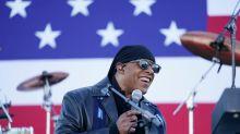 Stevie Wonder slams Trump over Proud Boys and coronavirus at rally with Biden and Obama