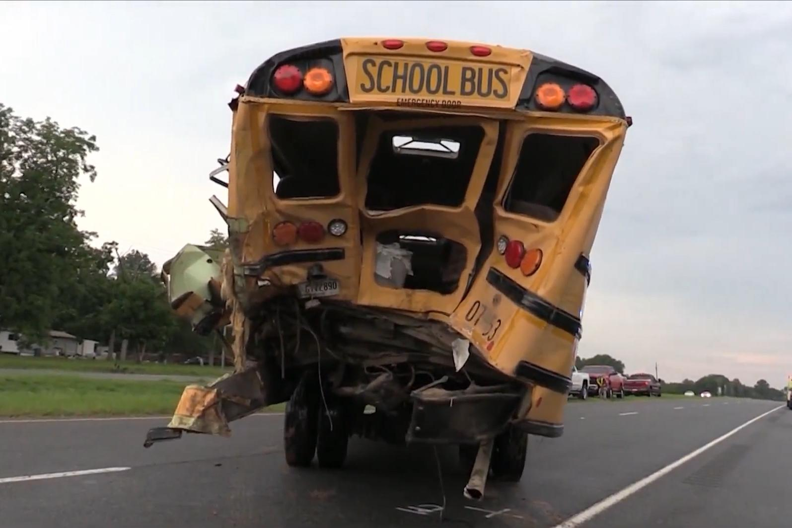 Truck driver in school bus crash helps free trapped kids, then collapses