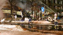 Japan police investigate cause of blast that hurt 42
