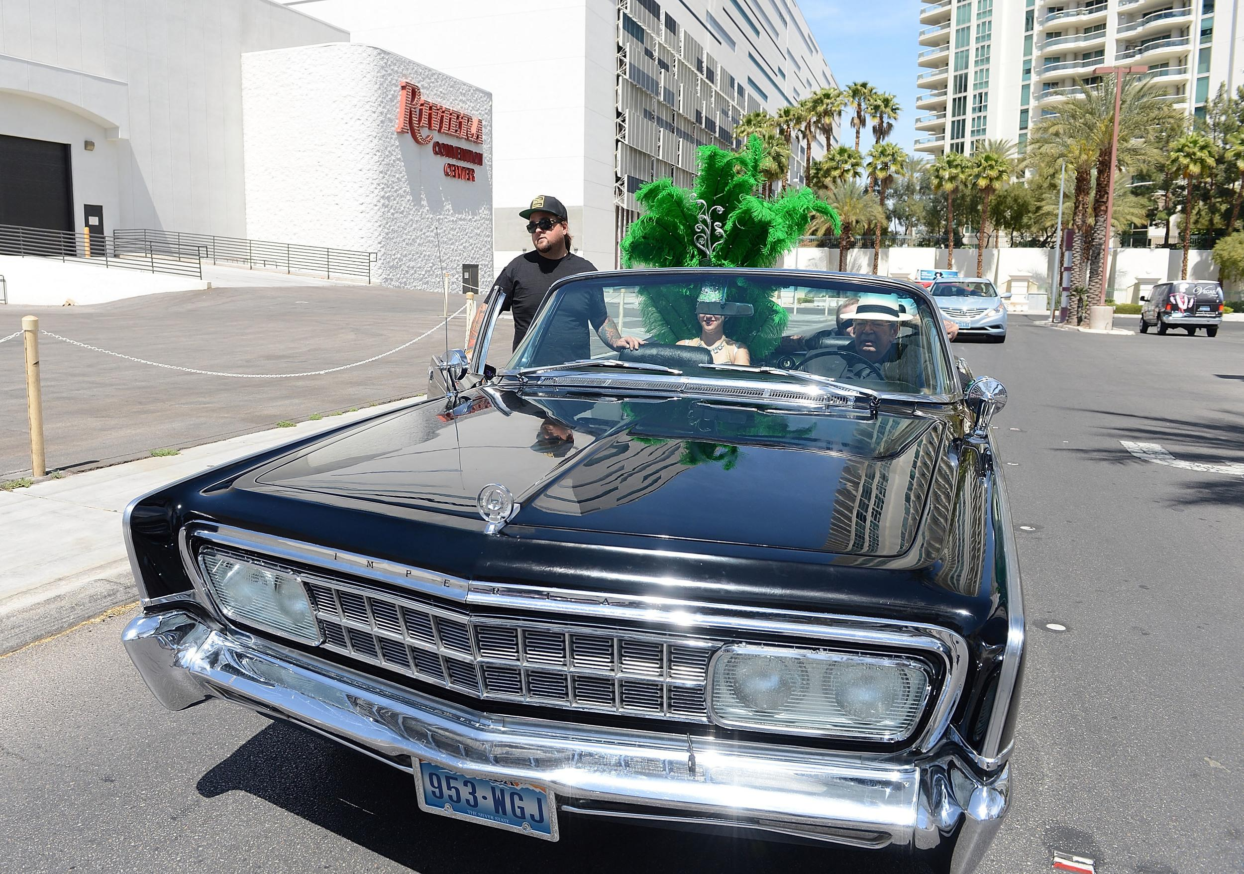 LAS VEGAS, NV - APRIL 16:  History's Pawn Stars Chumlee and Richard Harris drive down the Las Vegas strip with the cast of PAWN SHOP LIVE! to the Riviera Hotel & Casino on April 16, 2014 in Las Vegas, Nevada.  (Photo by Denise Truscello/WireImage)