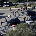 Florida shooting: Armed officer stood outside Parkland school building and did not intervene while 17 were killed